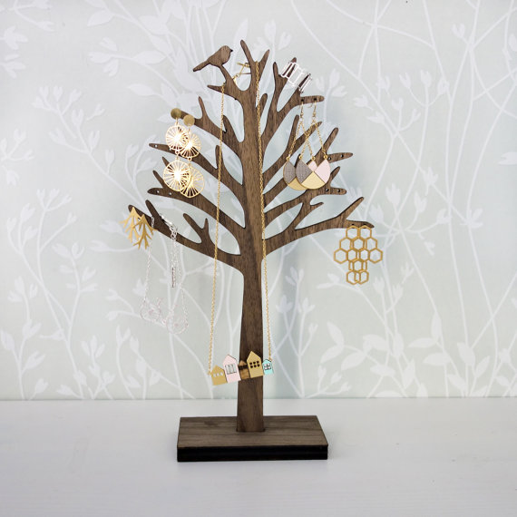 Wooden home decor and also a great jewelry organizer, jewelry holder, jewelry hanger and jewelry display. And it comes as a cute tree shape with a little bird on it.