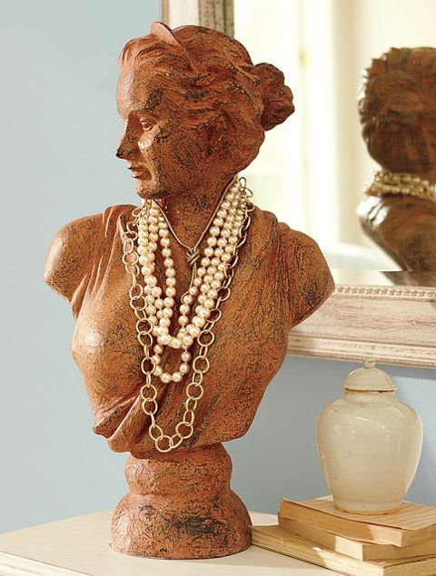 A bust statue is one of the most discrete ways to display jewelry, and so is this female bust used for holding necklaces.
