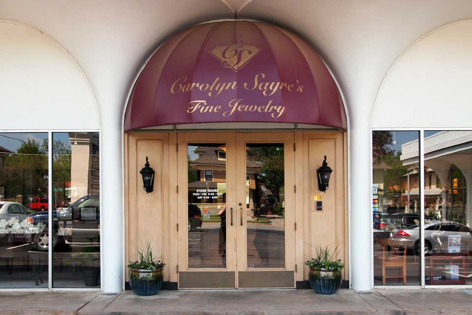 Impressive entrance with a purple half dome and gold lettering from Carolyn Sayre's Fine Jewelry. A storefront with a great amount of personality.