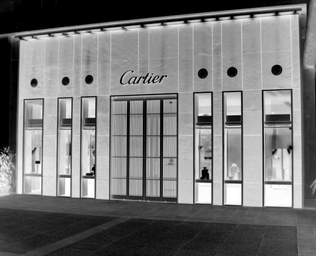 Black & white art represented by a Cartier storefront, with high glass display rectangles and a wide grid entrance.