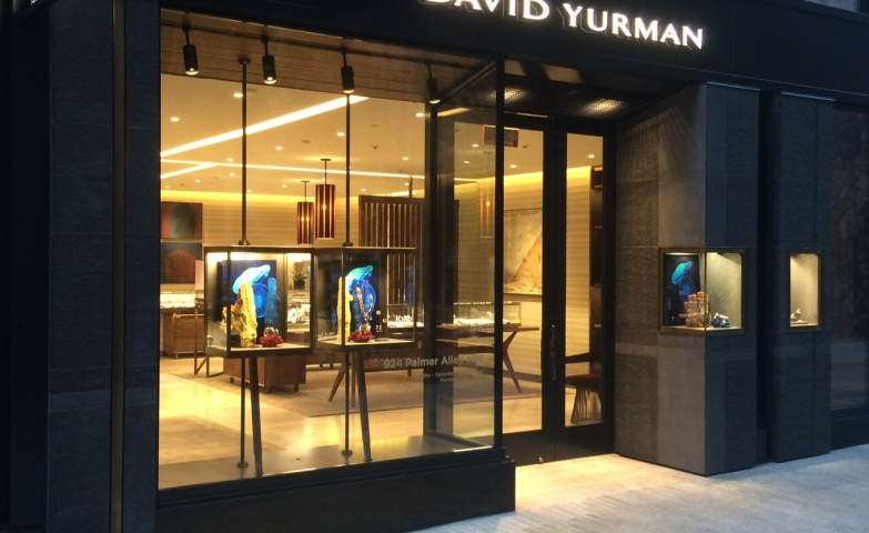 David Yurman exterior store design in DC, massive stone finish combined with big glass windows and in corner displays.