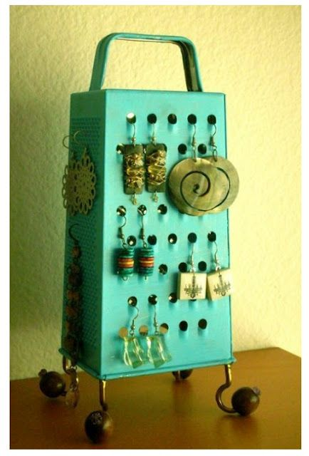 A rusty old cheese can always be restored and used as a cute earring holder display, just like this one.