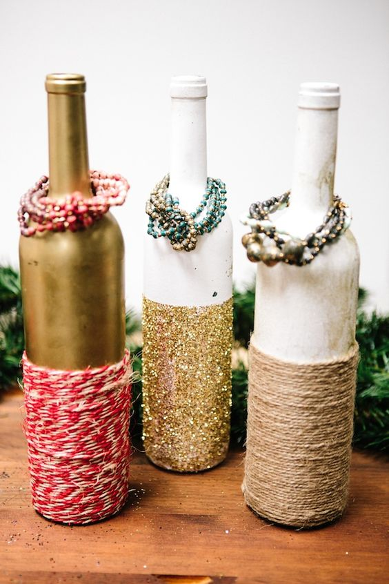 Use old wine bottles as easy and affordable jewelry display ideas. You can use spray or paint for the color, and some rope or glitter paper to add a personal touch.