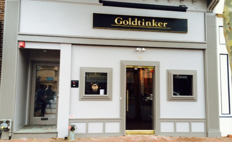 Goldtinker red bank jewelry went very discrete with their store front, allowing very little to show from the outside and boost curiosity of the ones passing by with this house like look.