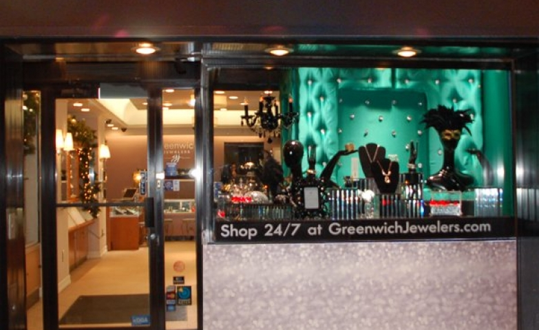 Greenwich Jewelers in New York, store front with a unique carnival like vibe, from the display pieces and the vibrant turquoise background of the main display.
