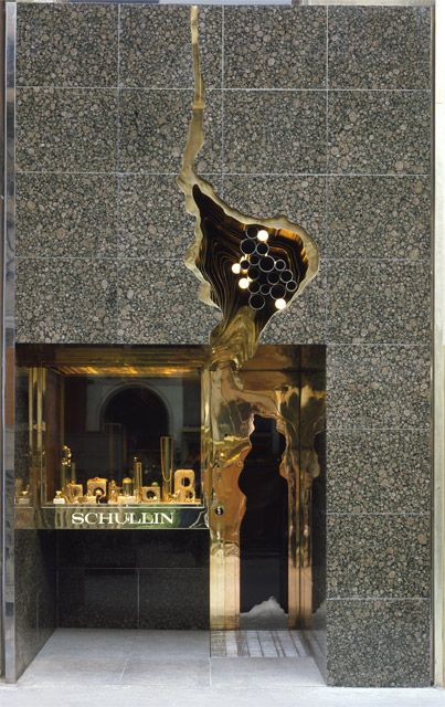 The store front of the Schullin Jewellery with a design by Hans Hollein will surely catch the eye of anyone, since its architecture is so inspiring and unique. Gold, grey marble and a weird hole like design on the exterior.