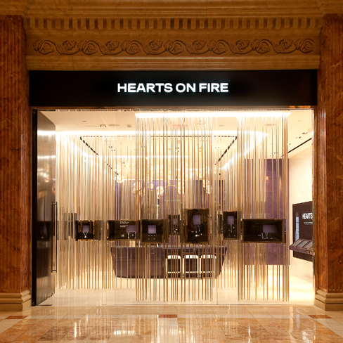 Marble pillars, rain installations and small discrete display boxes. This is what characterizes the store front of Heart On Fire, definitely a crazy unique design.
