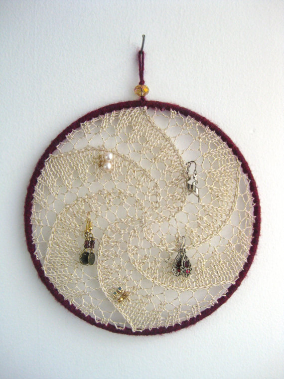 This sun-catcher/dream-catcher with gold embroidery and cranberry red lining is an awesome jewelry organizer, jewelry display and earring holder.
