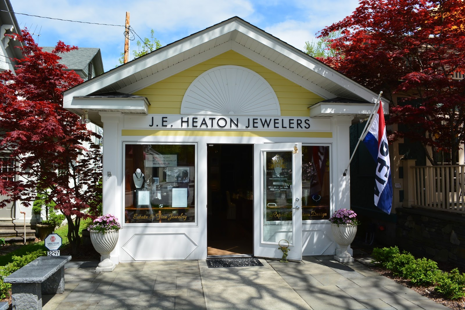 J. E. Heaton Jewelers store look like a tiny american colonial house, with a classic display and a cozy exterior setting.