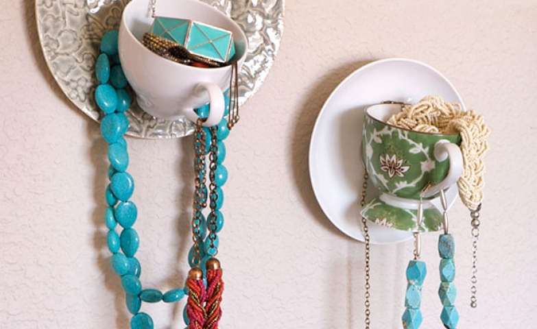 This hanging teacup display is a cozy delight for any boutique jewelry.