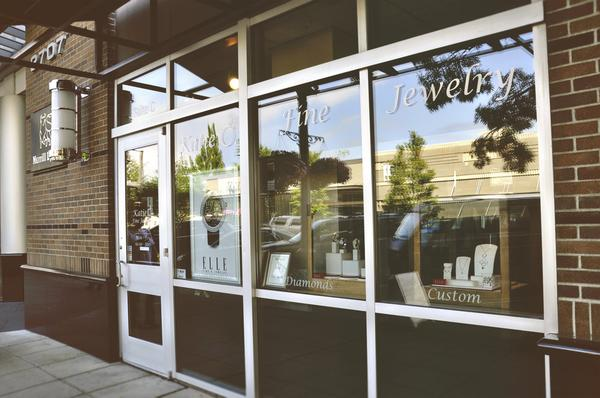 Glass boxes with wooden frame for the jewelry display, glass windows and a pretty classic exterior is what Katie O Fine chose for their jewelry storefront.