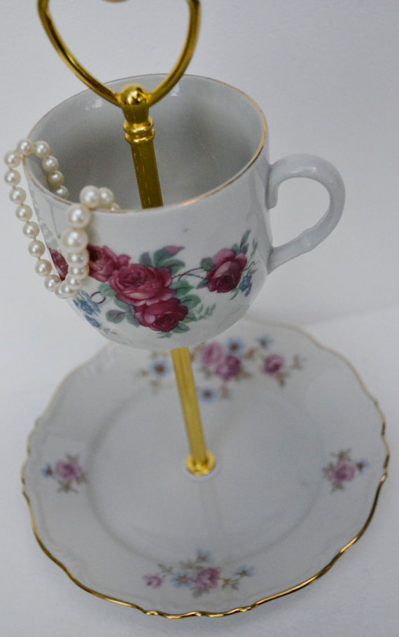 Vintage looking jewelry display teacup stand, with a red pink rose teacup and matching plate.