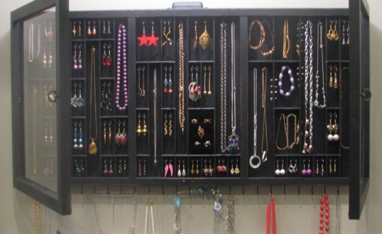 Black with glass doors jewelry organizer by Black Forest Cottage on Etsy, for hanging earrings, bracelets and necklaces.
