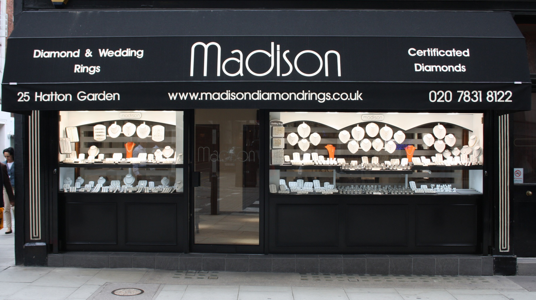All black exterior, abundant display, and a big white logo. This is the idea that Madison Jewellers chose to go with for their shop in Hatton Garden.
