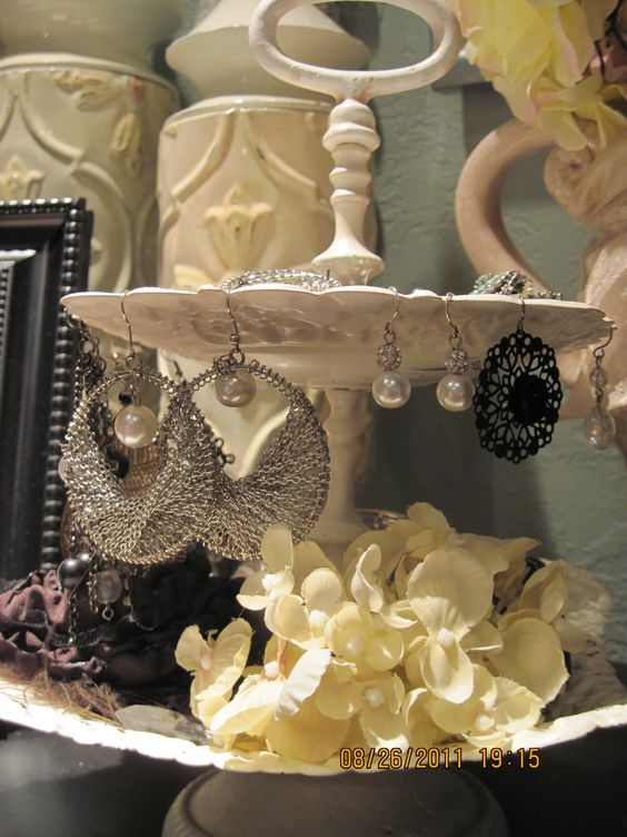 Jewelry display for earrings and necklaces, with flower decor. Reuse everyday items or give ordinary household items a new purpose.