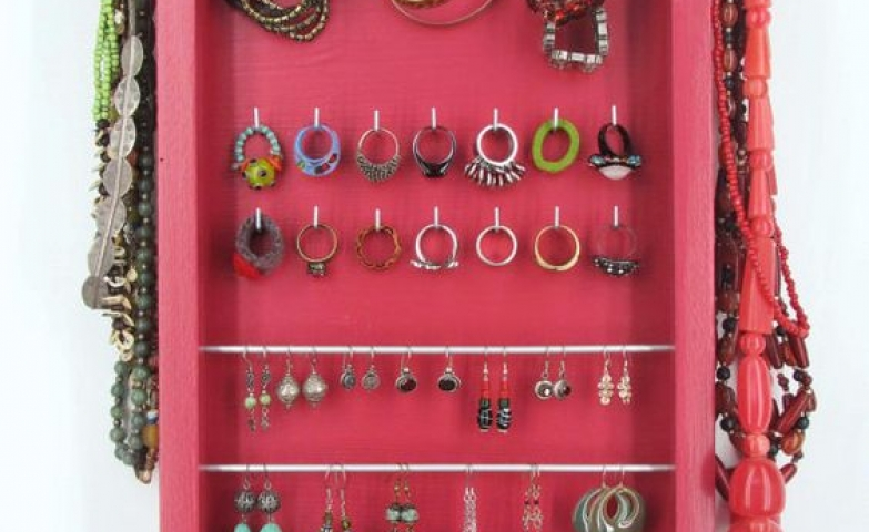 Red jewelry organizer from Etsy with hooks for hanging your precious earrings, bracelets or necklaces.
