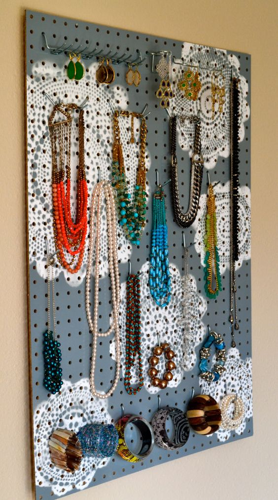 This jewelry holder custom hand painted with grey mandalas is a really nice piece as a jewelry organizer wall display.