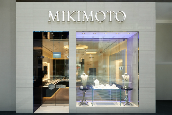 Mikimoto's storefront is simply futuristic, radiating japanese luxury. Big glass window display with neon lights, tall glass entrance and bright logo make it very curious.