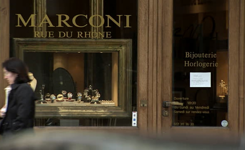 A view of the storefront of Marconi Jewelers with its sparkling jewels displayed in a box with a massive painting wooden frame. Also, the wooden finishes on the exterior give it a great touch.