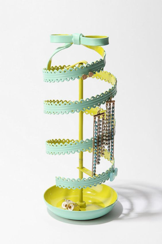 Light blue and electric yellow jewelry stand for hanging earrings and holding small rings.