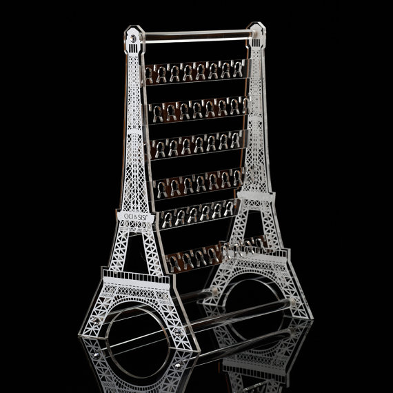 Jewelry storage stand imitating Eiffel Tower with rack made from acrylic for table placement. Great earrings organizer, earrings holder and earring display.