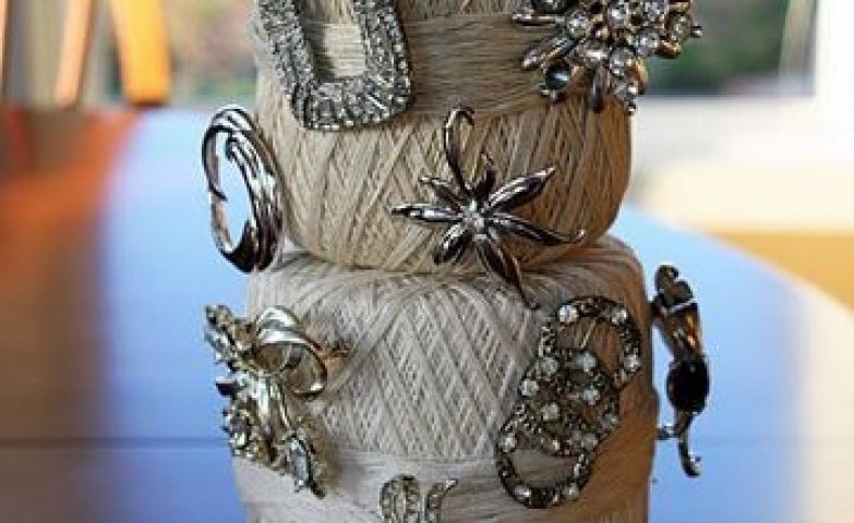 Jewelry storage ideas and craft inspiration, made with white thread balls placed on a stand.