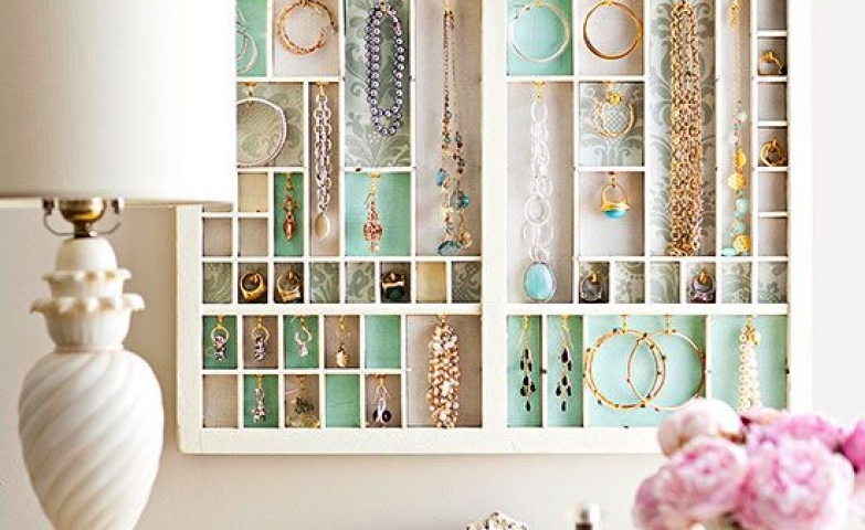 Jewelry storage idea for hanging on the wall, with different sized boxes for hanging necklaces, bracelets, earrings and even for storing rings.