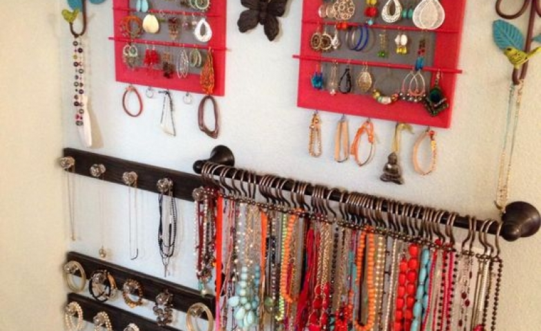 A jewelry wall which can be installed either in the closet or on the back of a door, with different hangers for all kinds of jewelry.