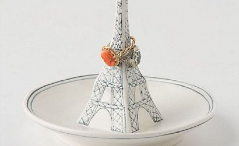 Eiffel Tower landmark imitating ring dish made from ceramic, with white finish and fine blue lines.