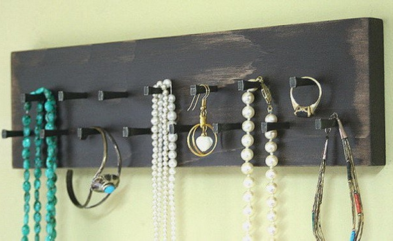 Want a fast and easy way to store some jewelry? A key rack can serve that purpose and create a perfect jewelry holder and organizer storage for any necklace, bracelet, earrings or even ring.