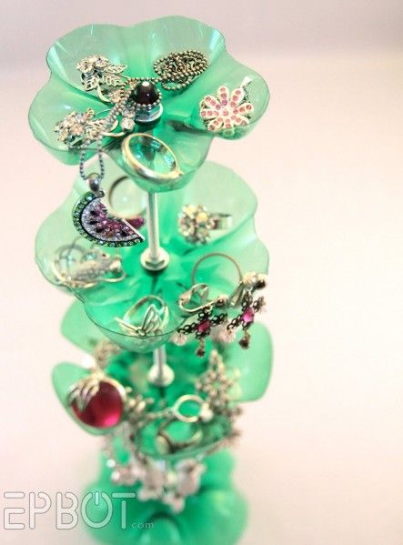 Make a jewelry stand from a recycled soda bottle, it's a great funky idea for holding jewelry.