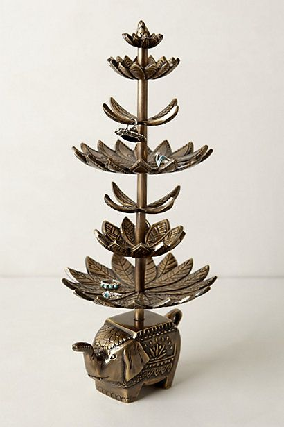 Minga metal jewelry stand with small elephant base and leaf themed plate holders and hangers.