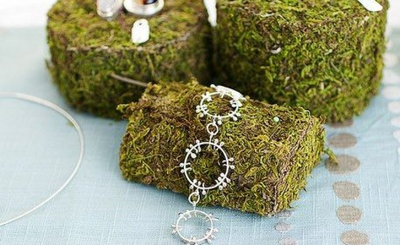 Moss covered Styrofoam pieces are a great idea for an interesting display that can be used for jewelry. Also you can cut it into any shape you want.