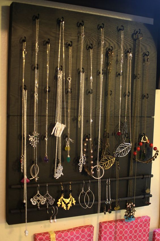 This jewlery organizer is made from a black wooden board, some black hangers and black metal bars. Easy and simple solution for storing and organizing.