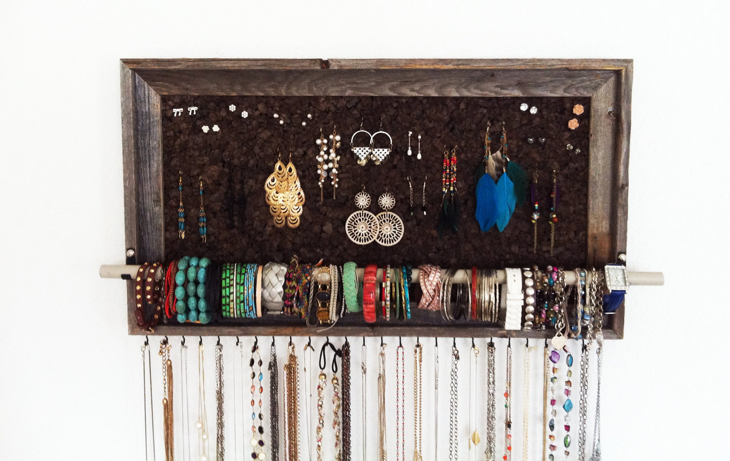 A very rustic look from this large barn wood jewelry organizer by AfterTheLeavesFall. Serves very well for keeping earrings, bracelets and necklaces.