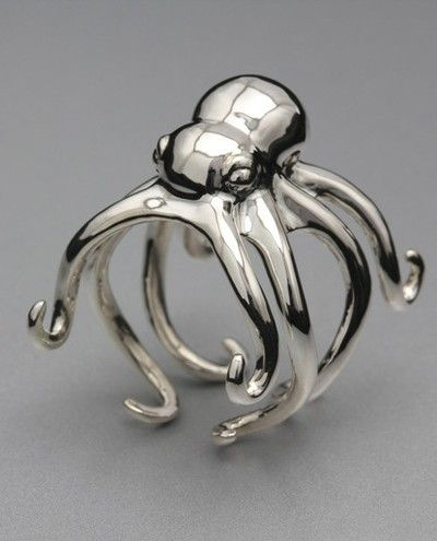 Octopus shaped ring holder, with chrome finish. Super cute and great for display and storage.