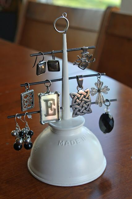 Yet another reuse idea, an oil can turned into jewelry holder with mate white paint finish for pendant and earrings storage.
