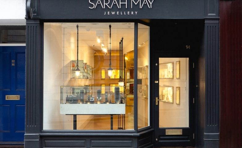 The Sarah May Jewellery look more like a gallery from the outside and reflects elegance with its mate black entrance and glass display, at Richmond in London, UK