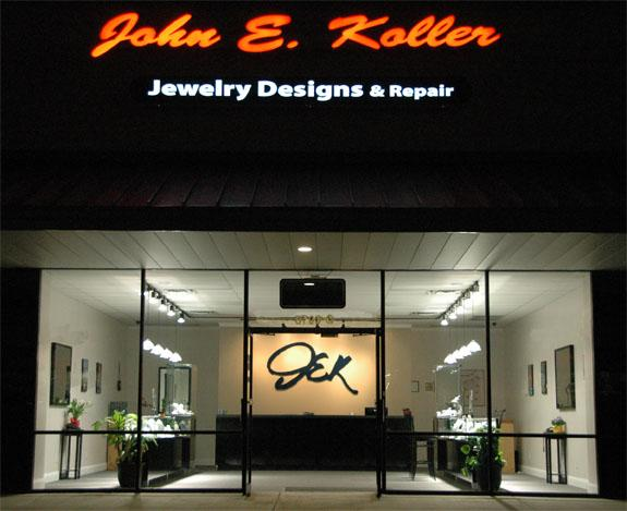 Simple yet inviting store front from John E. Koller jewelry, all glass front revealing what you can find inside, an elegant and symmetric setting with bright lights