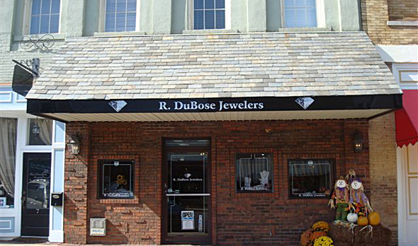 The store front of R. DuBose Jewelers looks like a small cottage, it doesn't reveal much of the merchandise but it definitely invites passers-by to take a peek inside