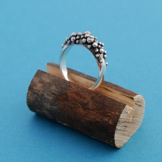 One of a kind ring display piece made from wood perfect for any nature themed display