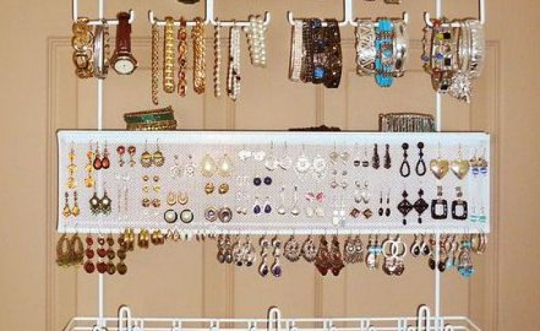 A complete jewelry organizer which can also help you with space saving? It's possible with an over the door jewelry organizer just like this one.