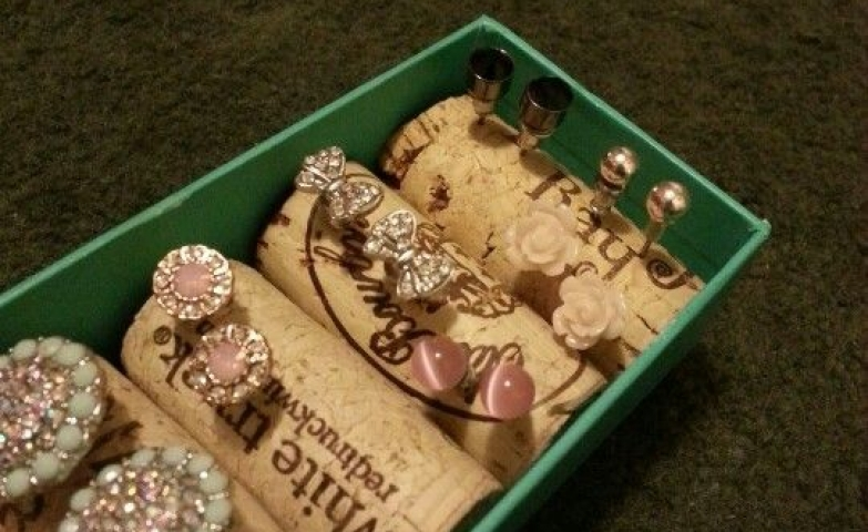 A simple and cute way to recycle corks by using them as jewelry display for earrings