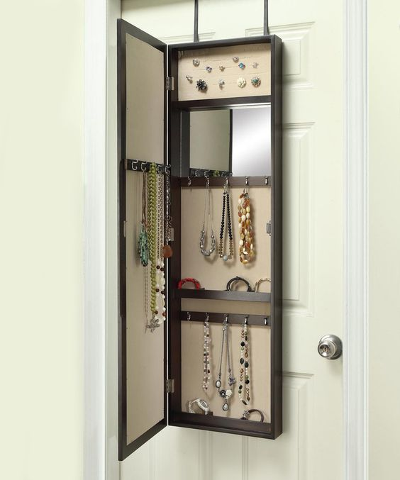 They come in different shapes and sizes, just look at this over the door jewelry organizer by Hives. It even has a mirror inside!
