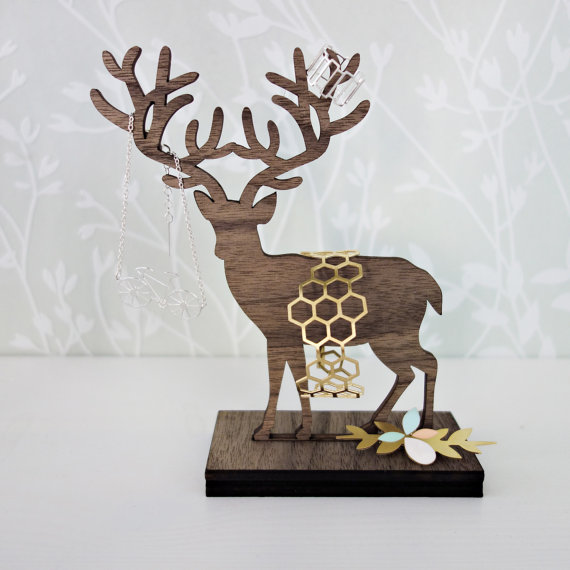 This standing wooden deer jewelry hanger is a great organizer and fine home decor piece