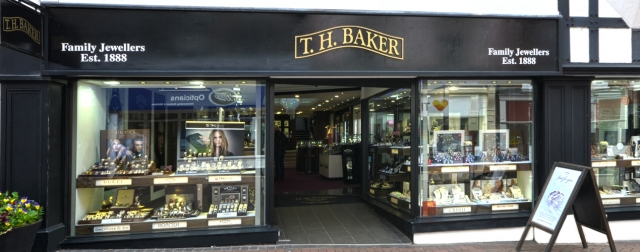 One can see they've been around since 1888, they keep it classic and elegant with the black front, display glass windows and gold logo. Inspiration from T.H. Baker seen in Shrewsburry.