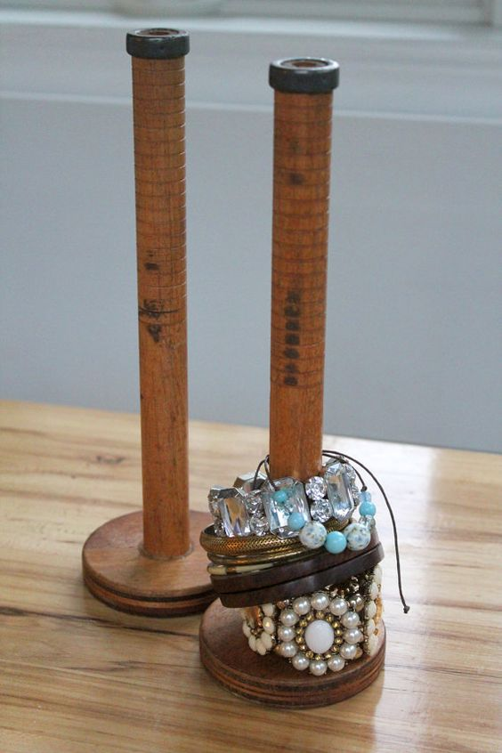 Vintage wooden spool used for bracelet display, an unusual jewelry holder and organizer.