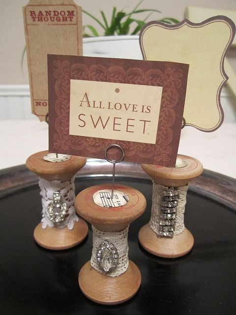 Vintage spools used for displaying vintage jewelry pieces, with cute message cards on top.