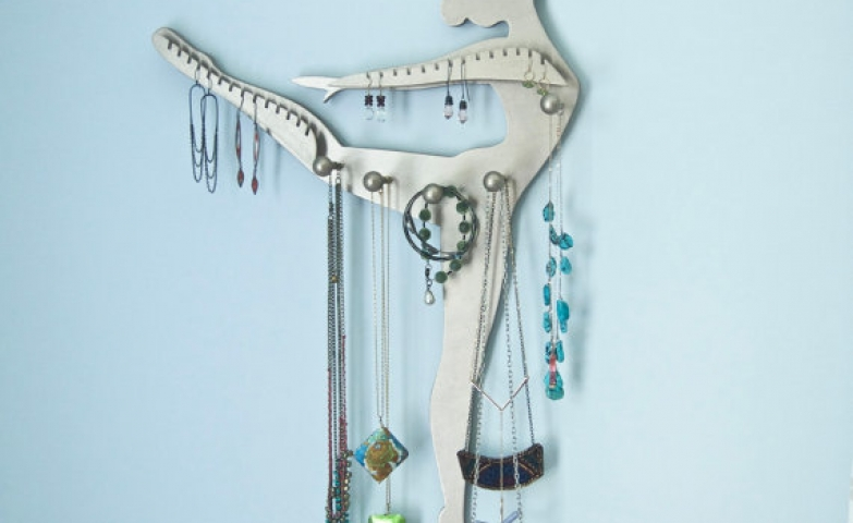 Warm silver dancer facing right shaped jewelry display, for hanging and storing small earrings and delicate necklaces.