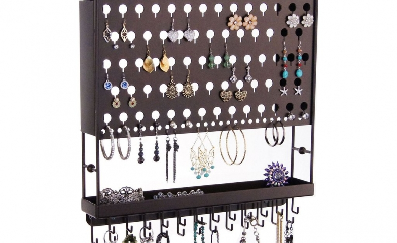 Cute looking metal hanger, which can be placed on a wall or a door and is perfect for storing and hanging different kinds of accessories.